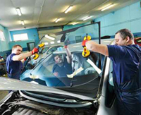 Workers doing the final touches in the vehicle production line.