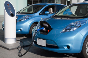 Electric vehicles charging at stations.