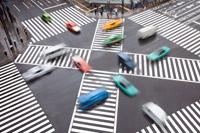 Low-emission cars crossing roads.